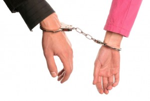 Man and woman handcuffed to each other