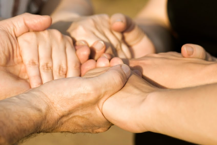 family holding hands - detachment from addiction