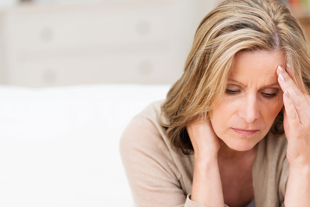 woman looking concerned - are you an enabler - no more enabling - signs you are enabling your loved one's addiction